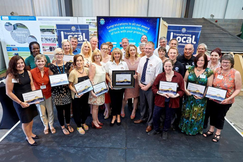 The winners of Jewson's Building Better Communities competition with Sarah Beeny (centre)