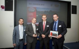 Jon Hammersley, David Hammersley and Gary McCaffrey of Hambro Roofing pick up two awards for Heathfield Infant & Junior School, Twickenham