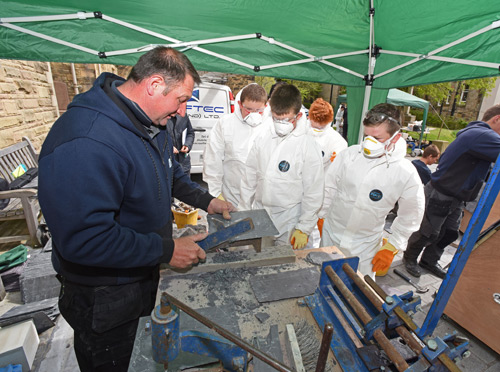 NFRC Scottish Trade Member, Rooftec (Scotland) demonstrating slate cutting to school-children in Falkirk as part of the Scottish Apprenticeship Week 2015