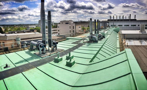 The newly refurbished roof of the Joseph Black Building with Sarnafil Membrane S327-15EL in patina green