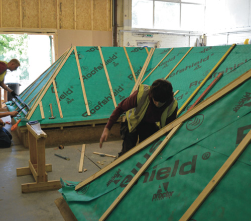 Roofing apprentices using Rubershield breather membrane from A. Proctor Group