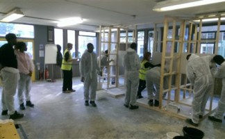 Visitors to the Construction Youth Trust Training Centre gets to grips with construction skills