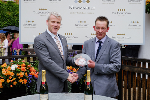 John McMullan, commercial manager at Firestone Building Products (left) with James McCarthy (right) representing the owners of the Firestone Handicap Stakes winning horse