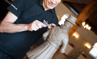 Ian Martinson, production team leader at Wienerberger, creates a clay beefeater to showcase Keymer's traditional skills