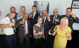 Filon Products' employees toast the recent management buyout