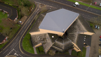 The Kerith Community Church's sloped fan-shaped roof with new Sika Sarnafil G410-18ELF Lead Grey membrane