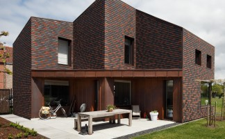 The zero carbon family home in Belgium has been clad entirely in clay plain tiles from Marley Eternit
