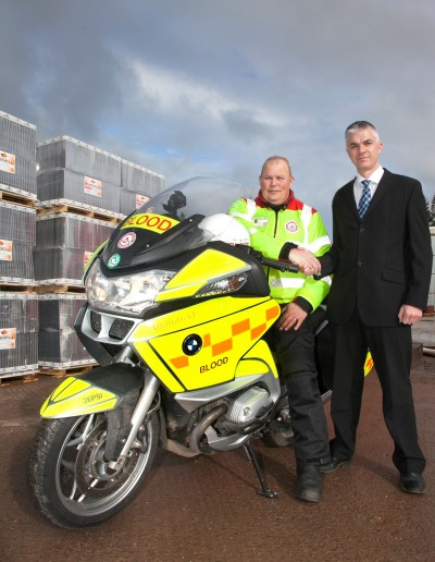 L-R Dave Hook, chairman of Dumfries Galloway Blood Bikes and Bruce Laidlaw, production director at Russell Roof Tiles