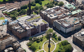 An artist's impression of the new development (centre of picture with green coloured roof)