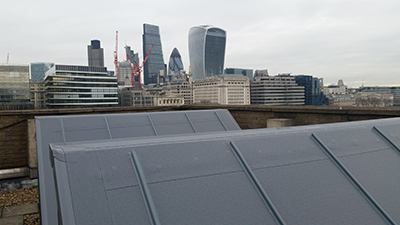 Hybrid Roofing solved the problem of weather ingress through the banks of 26 metal-clad northlights using Protan's SE1.2mm single ply membrane standard overlap