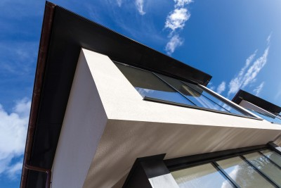 A decorative scraped texture finish has been applied to the White render, which catches and holds the light