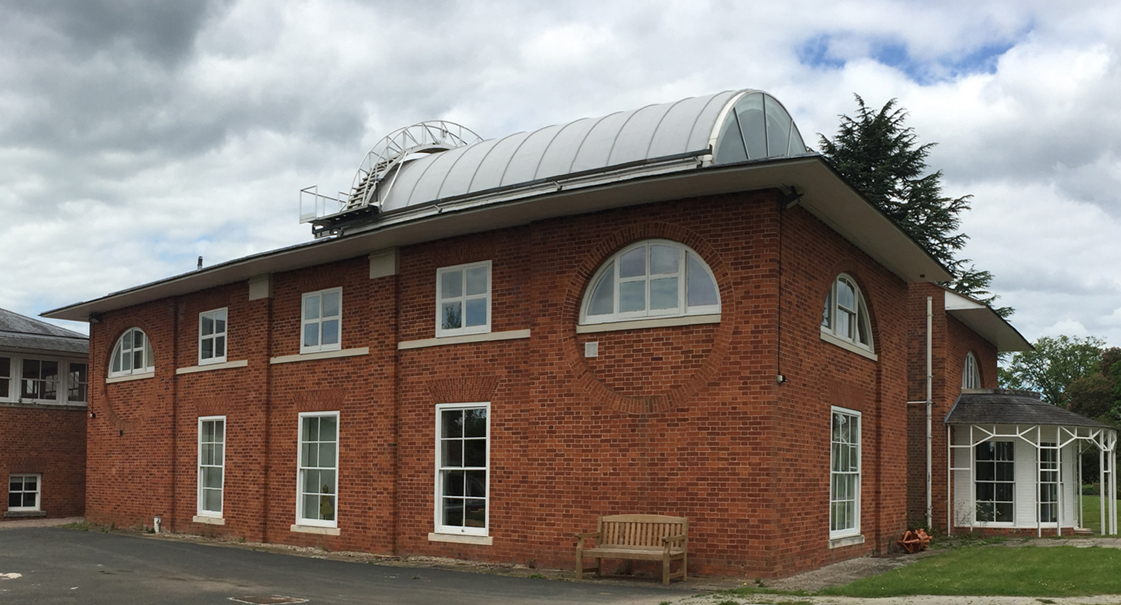 The project involved removing an existing barrel-shaped polycarbonate roof and replacing it with a new single ply roof that had both excellent performance and minimal environmental impact as well as look good both inside and out