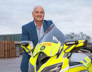 Andrew Hayward MD Russell Roof Tiles with a blood bike