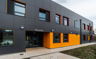 Designed by international design practice Scott Brownrigg, the new purpose-built premises spans several buildings all clad in grey and orange laminate from Abet Laminati's exterior grade high-pressure laminate collection
