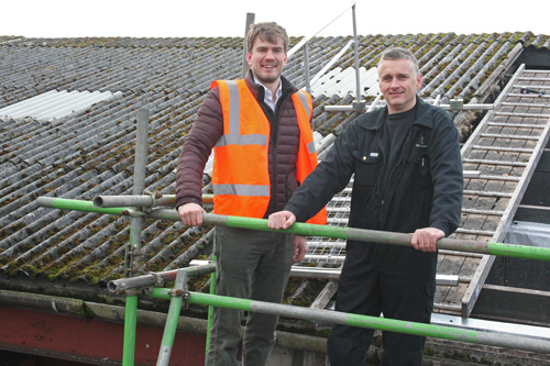 (L to R) Alex Tilley and Thomas Cowan of Robson & Cowan where the existing roof is being replaced by a new profiled metal twin skin system with insulation to meet building regulations