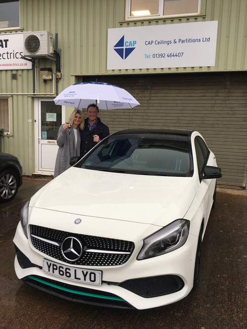 Gary Rice & his partner take delivery of his brand new prize