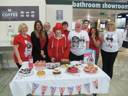 Covers staff selling cakes during the Red Nose Day event