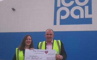 : (R-L) Simon Woods from Icopal handing over the cheque to Jennifer Bailey from The Christie charity
