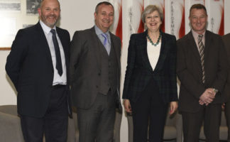 (L-R) Theresa May, divisional director Dave Embery, managing director Anthony Carlyle and factory manager Andrew McArthur