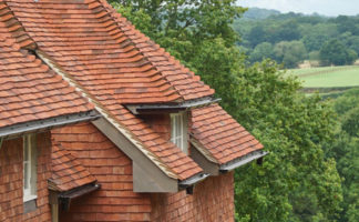 The soft sand granulation on the surface allows the tiles to weather and mellow rapidly; this aging gives the impact of a matured roof in a very short time.