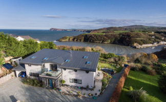 The home, which sits on the Pembrokeshire coastline, is able to withstand the rigors of coastal weather and remain well insulated [Photo Credit: Daniel Smart Photography]