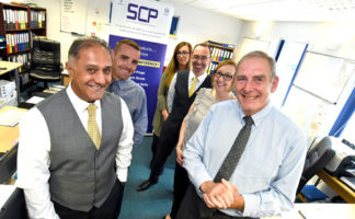 Ron Johnson, group commercial director (front right) and Dale R Dale, group managing director MSUK (front left) with the SCP team.