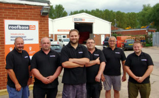 Lee House, general manager (front and centre), with the team at the new Roofbase store in Exeter.