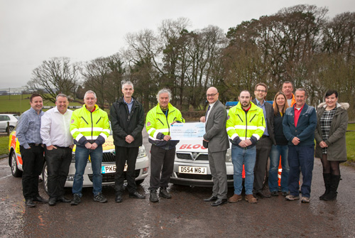 Andrew Hayward (Centre) and the Lochmaben team presenting the cheque to Blood Bikes