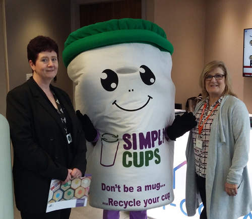 Left to right: Environmental manager Jayne Kennell, Simply Cups mascot 'Cupbert' and ISO standards specialist, Angie Wright