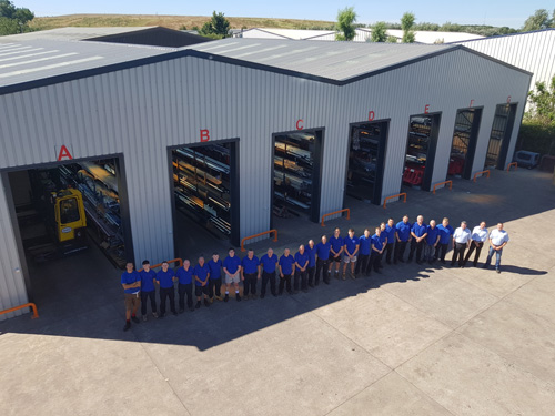 Production team in front of Dudley's new facility