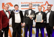 Actis specification manager, Dan Anson-Hart, joins Jon Culshaw to present a trophy to the winner of the best individual new build house at the LABC Building Excellence Awards