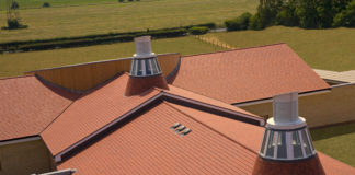 In terms of effective water drainage, a roof with a gentle slope discharges rainwater at a slower rate than a steeper roof, simply due to gravity