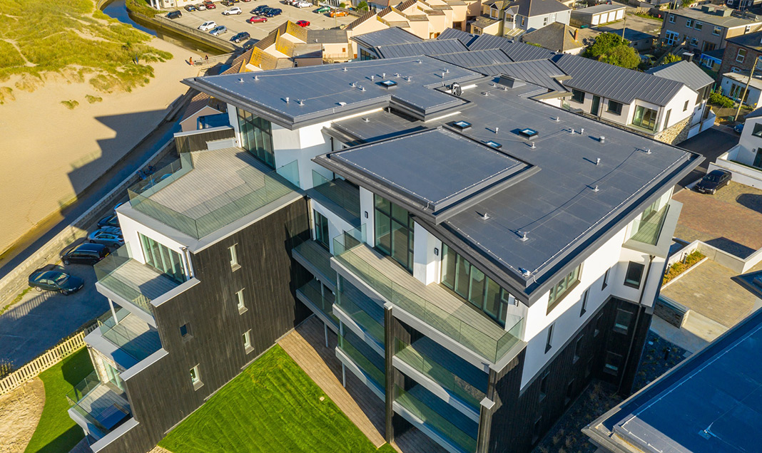 The Dunes development in Perranporth: The challenge was to create effective waterproofing and weather resistant solutions for both the roof and balconies.