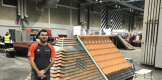 Joe Osborne, winner of the silver medal in Roof Slating & Tiling, next to his competition work