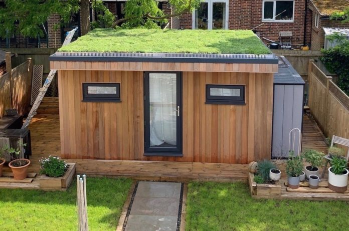 An example of Wallbarn's M-Tray modular green roof solution installed on a garden building