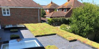 Wallbarn's M-Tray modular green roof during installation on a domestic flat roofed home extension