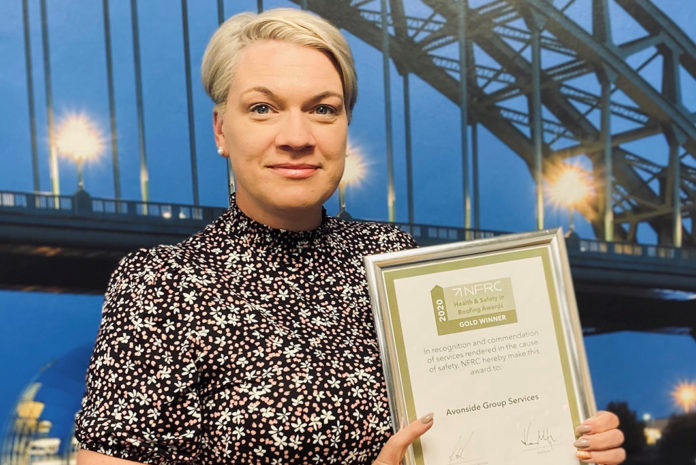 Sarah Burke with the NFRC Health and Safety Gold Award winner certificate