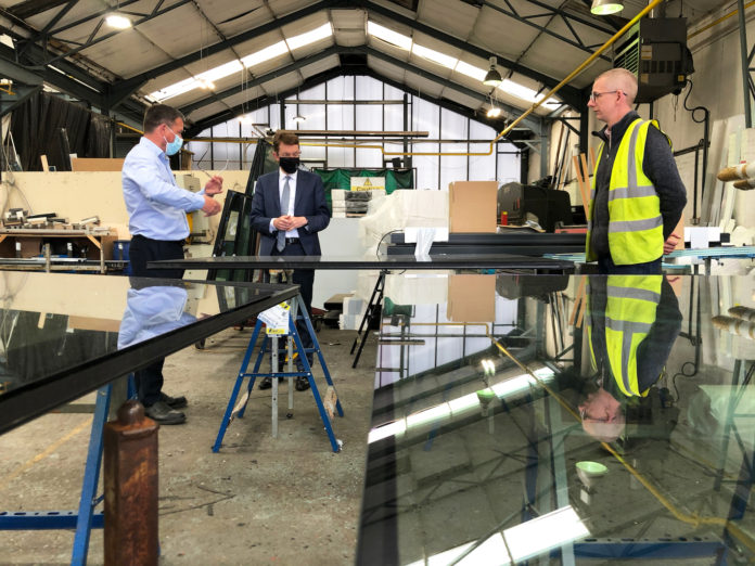 Mayor Andy Street (centre) visited Howells Patent Glazing to find out some of the measures it has put in place to support the mental health and wellbeing of its employees