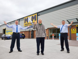 Cricket legend Dickie Bird officially opens MKM Building Supplies' new Barnsley branch with co-branch directors Mark Winstanley and John Lea.